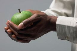 Fruis of the Holy Spirit man holding apple