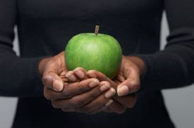 Christian Nutrition - Woman holding an Apple