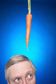 Christian Fasting - Man Looking at Carrot