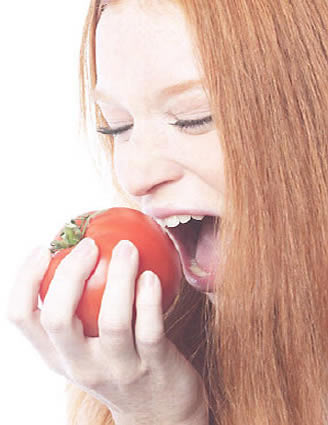 Choosing Bible Foods- Woman biting a tomato