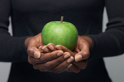 Christian Nutrition - Woman holding an Apple