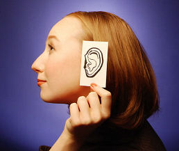 How to Hear God's Voice - Woman holding paper ear