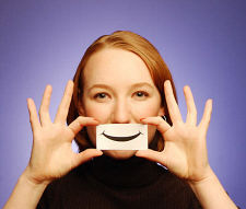 Controlling Emotions-Woman holding paper smile
