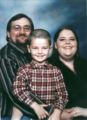 My husband Johnny, me (Keli) and my beautiful son Wyatt.