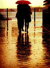 christian spiritual growth couple under umberella in rain