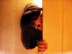 family Bible study kid peeking from behind door