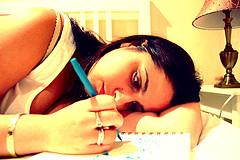 woman writing in Christian prayer journal