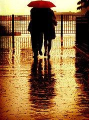 christian spiritual growth couple under umberella in rain