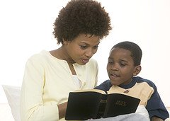 Family time Bible Studies - Mother reading Bible to son